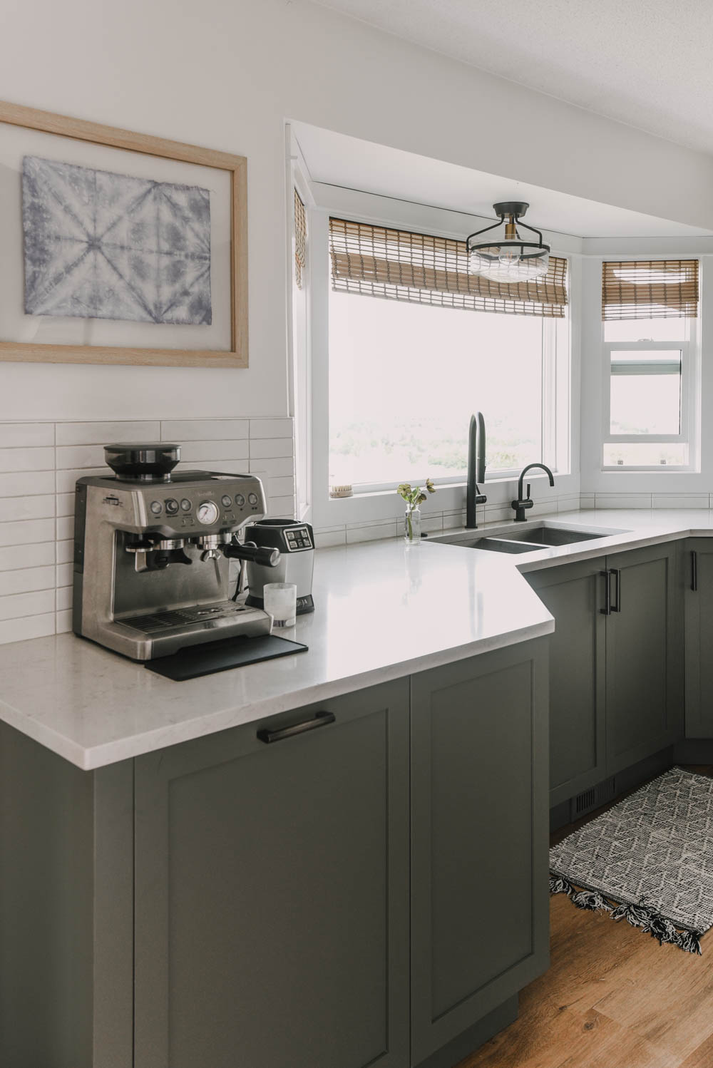 muted green shaker cabinets