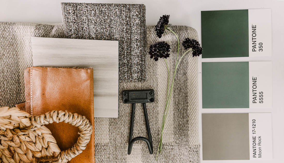 cozy green and neutral design board for a mudroom