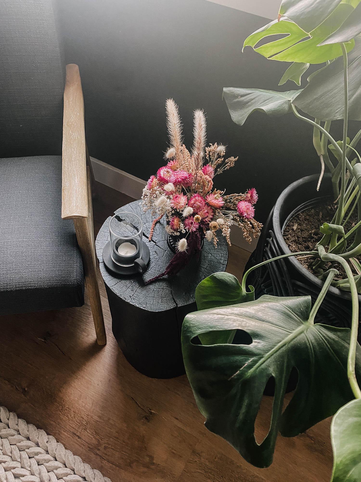 dried floral arrangement on stump table