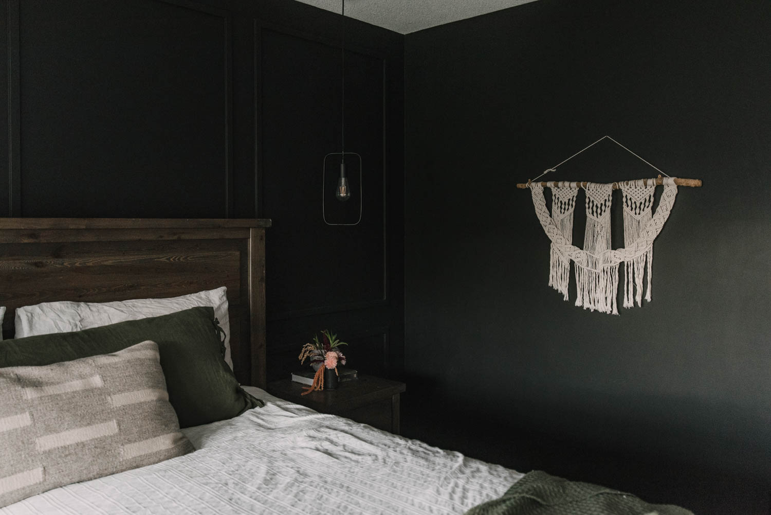 primary bedroom with black paint and fall florals